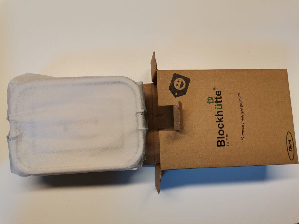 Blockhütte Dose in Papier verpackt